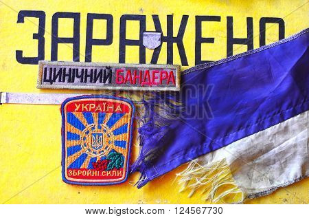 Kiev,Ukraine.FEB 20.Illustrative editorial.Chevron of Ukrainian with CONTAMINATED warning of CD as background (ru)Army.At February 20,2016 in Kiev, Ukraine