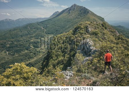 Man alone in mountain looking at hills
