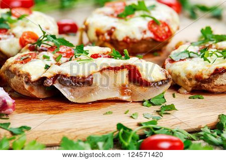 Cooked Mushrooms stuffed with cheese and plum tomatoes.