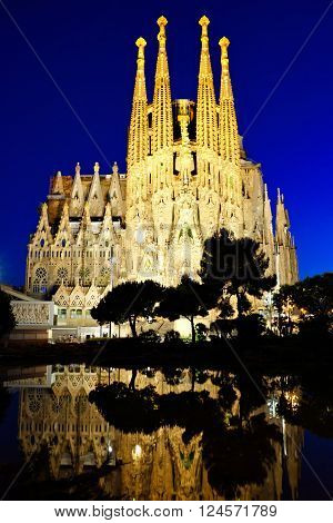 BARCELONA - JUN 4: Sagrada Familia at night on June 4 2015 in Barcelona Spain. The UNESCO World Heritage Site still under construction was designed by Antoni Gaudi and started in 1882.