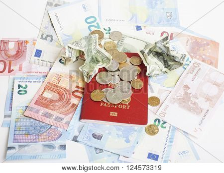 Travel on vacation lifestyle concept: cash money on table in mess with passport and change close up