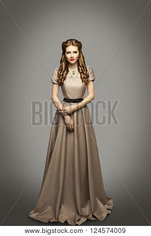 Woman Long Dress Fashion Model in Historical Gown over Gray