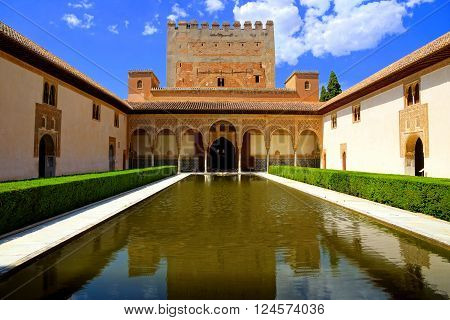 GRANADA - JUN 7: Courtyard of the Myrtles at the Alhambra, June 7, 2015 in Granada, Spain. The Alhambra is a UNESCO World Heritage Site and is one of the most visited attractions in Spain.