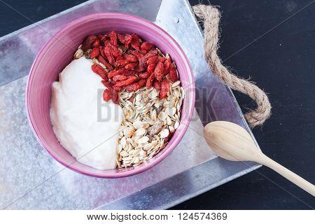 muesli with yogurt and goji berry fruit