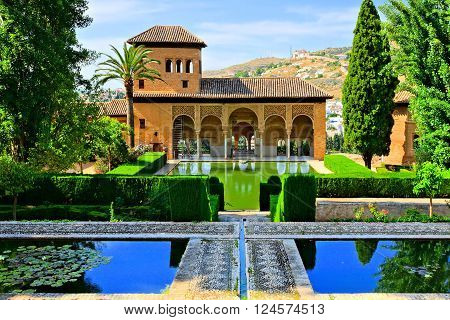 GRANADA - JUN 7: Gardens of the Partal Palace at the Alhambra, June 7, 2015 in Granada, Spain. The Alhambra is a UNESCO World Heritage Site and is one of the most visited attractions in Spain.