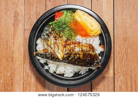 Japanese food style , Saba fish grilled set with rice on wooden background in still life style