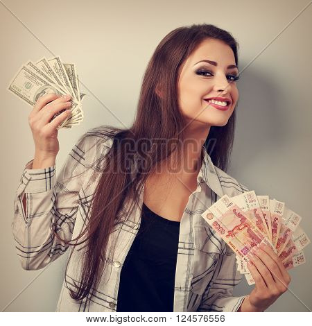 Happy Business Woman Thinking That Currency To Choose, Dollars Or Rubles And Choosing Dollars Holdin