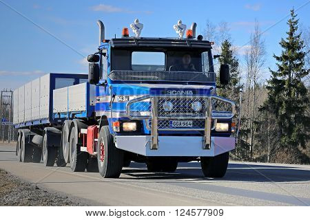 FORSSA, FINLAND - APRIL 2, 2016: Classic Scania 143H conventional truck and full trailer moves along road in South of Finland.