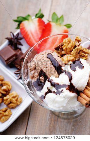 Ice cream sundae, chocolate and sliced strawberry