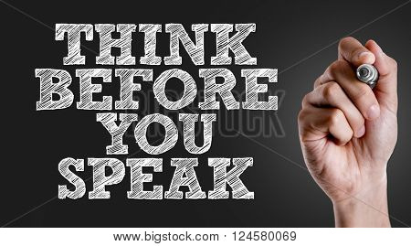 Hand writing the text: Think Before You Speak