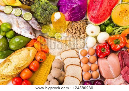 Group of healthy food the shoot includes protein carbohydrates good fats fruits and vegetables.
