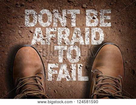 Top View of Boot on the trail with the text: Don't be Afraid to Fail