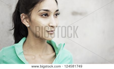 Athletic young woman lookign to side