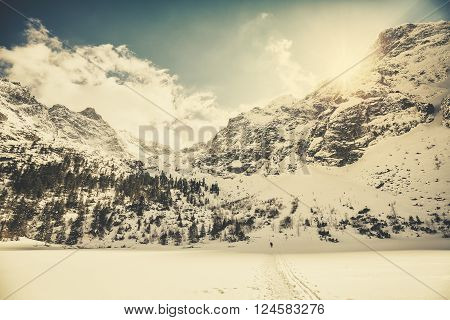 Retro Old Film Style Picture Of Tatra Mountains Against The Sun.
