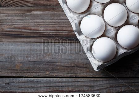 White eggs on a rustic wooden table