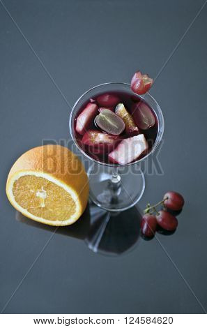 fresh fruit and refreshing Sangria in glass decorated.