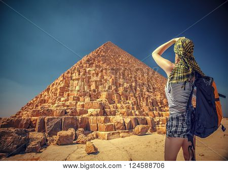 Woman Traveler With A Backpack And The Pyramids At Giza