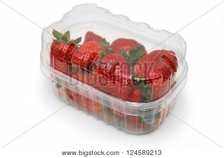 Box or punnet of strawberries isolated on a white studio background.