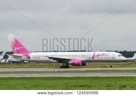DOMODEDOVO RUSSIA - JULY 20: Aircraft operated by Vim Airlines taxiing at Moscow airport in Domodedovo on July 20 2013. The company in its fleet has 11 aircraft Boeing-757-200