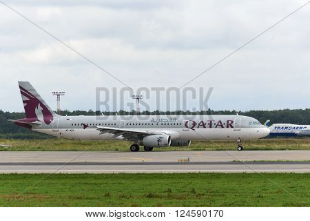 DOMODEDOVO RUSSIA - JULY 20: Aircraft operated by Qatar Airways readiy to take off at Moscow airport in Domodedovo on July 20 2013. The company in its fleet has 12 aircraft Airbus-A321