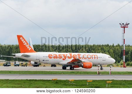 DOMODEDOVO RUSSIA - JULY 20: Aircraft operated byEasyJet taxiing at Moscow airport in Domodedovo on July 20 2013. The company in its fleet has 57 aircraft Airbus-A320