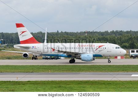 DOMODEDOVO RUSSIA - JULY 20: Aircraft operated by Austrian Airliness taxiing to runway at Moscow airport Domodedovo on July 20 2013. The company in its fleet has 7 aircraft Airbus-A319