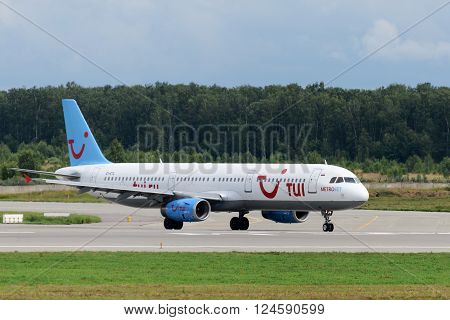 DOMODEDOVO RUSSIA - JULY 20: Aircraft operated by MetroJet ready to take off at Moscow airport Domodedovo on July 20 2013. The company in its fleet has 6 aircraft Airbus-A321