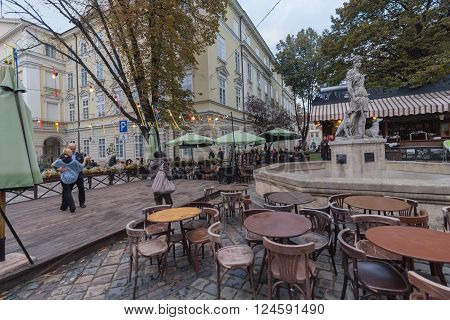 Lviv Ukraine - October 18 2015: Older people dancing in the evening in the open air street cafes