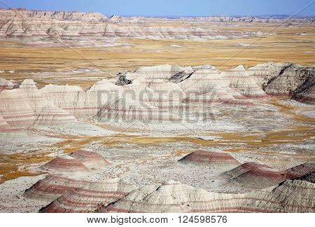 Landscape image of the Badlands of South Dakota, on a warm autumn day.