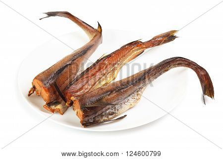 Cold smoked pink Pollock on plate isolated on a white background