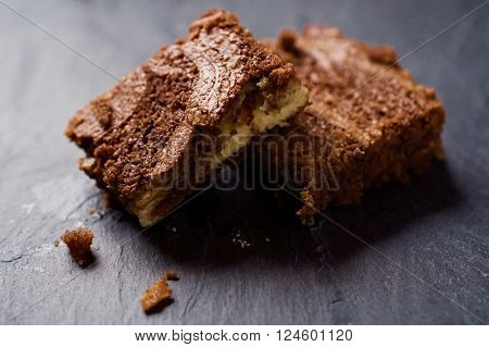 Marble cake brownies on top of each other. Selective focus.