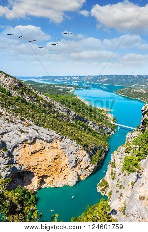 The largest alpine canyon Verdon spring. Emerald water of the river is flowing at the bottom of the gorge. Canyon of Verdon, Provence, France