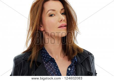 Attractive young woman in leather jacket, portrait over white background, isolated