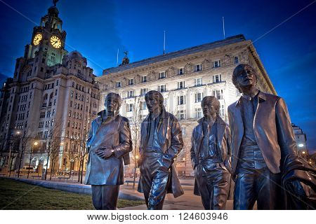 Liverpool, UK: APRIL 5th 2016 - A bronze state of the four Liverpool Beatles stands on Liverpool Waterfront, weighing in at 1.2 tonnes and sculpted by sculpture Andrew Edwards.