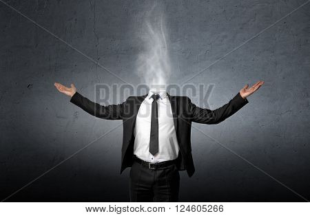 Smoke instead of a businessman head who raised his hands palm up. Front view