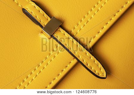Detail Leather yellow bags close-up,  leather textured background with buckle