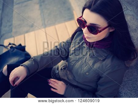 Young Hipster Girl In Parka Coat Outdoors