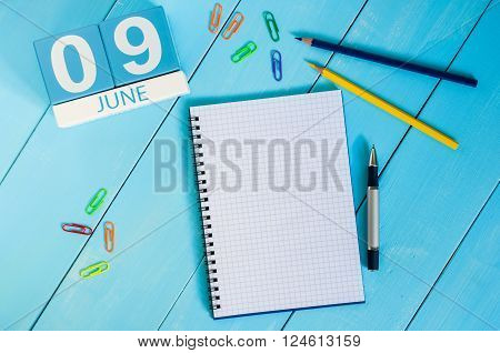 June 9th. Image of june 9 wooden color calendar on blue background.  Summer day. Empty space for text. International Friends Day. Archives DAY.
