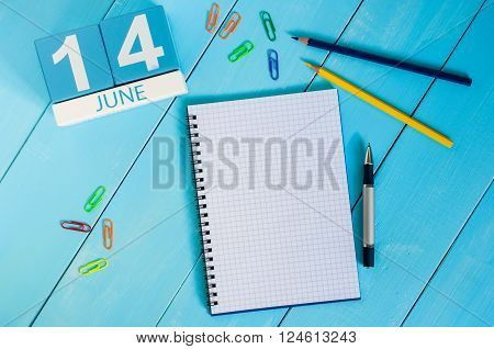 June 14th. Image of june 14 wooden color calendar on blue background. Summer day. Empty space for text. Blog Day.