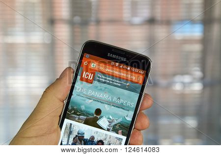 MONTREAL CANADA - APRIL 5 2016 : ICIJ web page on mobile phone. ICIJ is International Consortium of Investigative Journalists and well known for The Panama Papers.