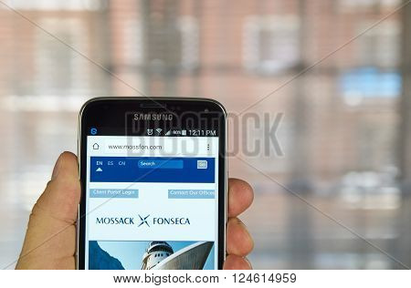 MONTREAL CANADA - APRIL 5 2016 : Mossack Fonseca page on mobile phone. Mossack Fonseca is a Panamanian law firm well known for the biggest leak in the history called The Panama Papers.