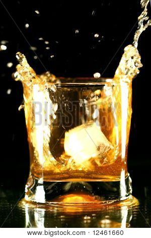 whiskey splash on black background