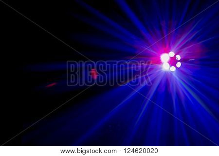 Light Shafts From A  Blue Coloured Disco Light