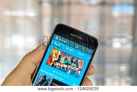 MONTREAL CANADA - APRIL 5 2016 : DC Comics application on cell phone. DC Comics is one of the largest American companies in comic books and related media publishing.