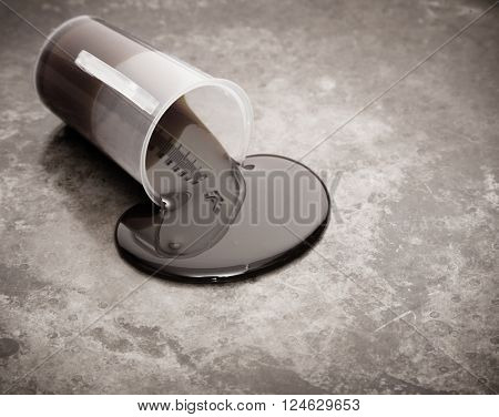 Crude oil spill on metal background