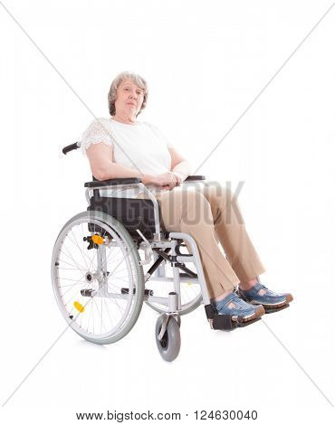 Senior woman sitting in wheel chair. All on white background