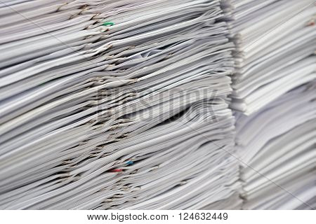 Pile of documents on desk stack up high