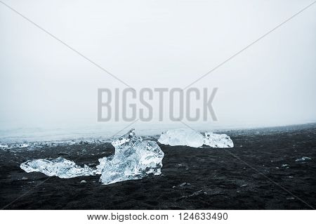 Icebergs On The Beach With Black Volcanic Sand In Iceland