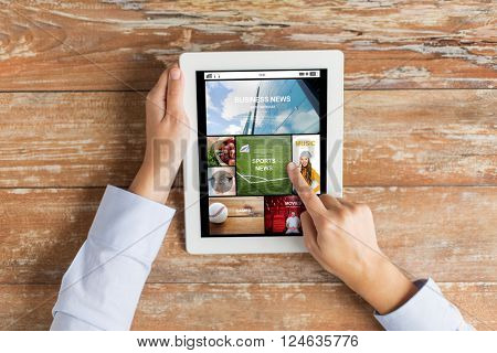 business, mass media, people and technology concept - close up of female hands pointing finger to news application on tablet pc computer screen