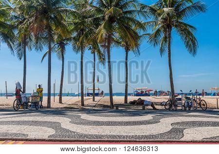 Rio de Janeiro, Brazil - December 21, 2012: Local people enjoying life at the beach at Copacabana Beach, Rio de Janeiro.